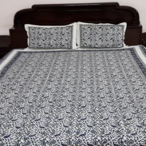 White and grey bedsheet with pillowcover