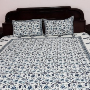 White and blue bedsheet with pillowcover